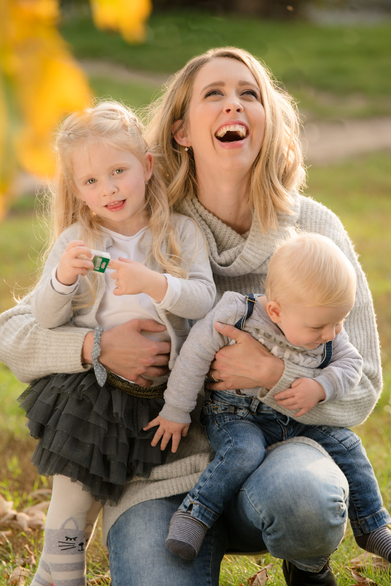 mother smiling with two children, photography